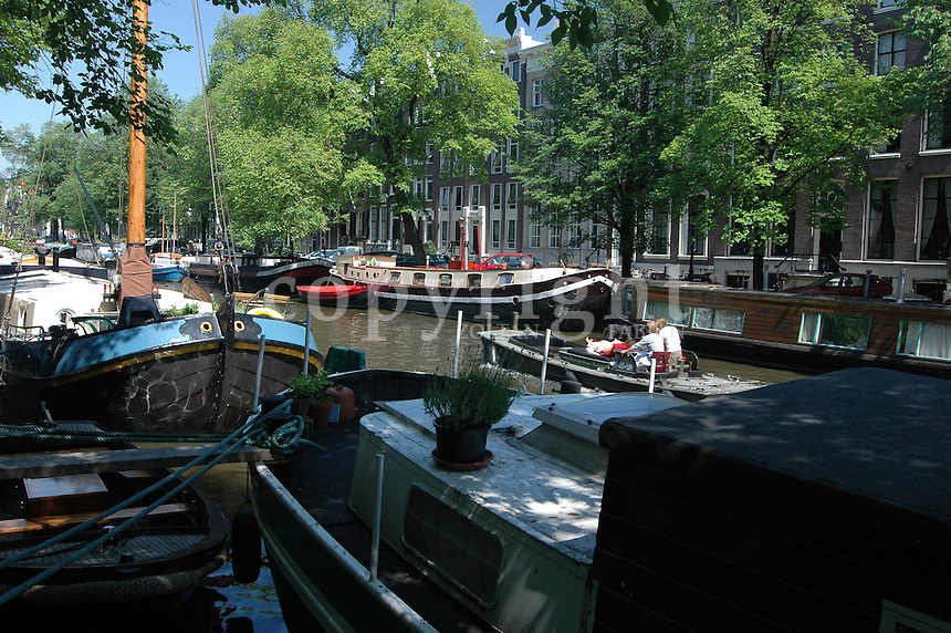 Boats and ships in the canal in Amsterdam