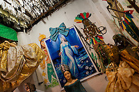 Yemanjá, the goddess of the sea, displayed as a beautiful woman in a Candomblé shrine (terreiro) in Salvador, Bahia, Brazil, 9 February 2012. Yemanjá, originally from the ancient Yoruba mythology, is one of the most popular ?orixás?, the deities from the Afro-Brazilian religion of Candomblé. Every year on February 2nd, thousands of Yemanjá devotees participate in a colorful celebration in her honor. Faithful, usually dressed in the traditional white, gather on the beach at dawn to leave offerings for their goddess. Gifts for Yemanjá include flowers, perfumes or jewelry. Dancing in the circle and singing ancestral Yoruba prayers, sometimes the followers enter into a trance and become possessed by the spirits. Although Yemanjá is widely worshipped throughout Latin America, including south of Brazil, Uruguay, Cuba or Haiti, the most popular cult is maintained in Bahia, Brazil.