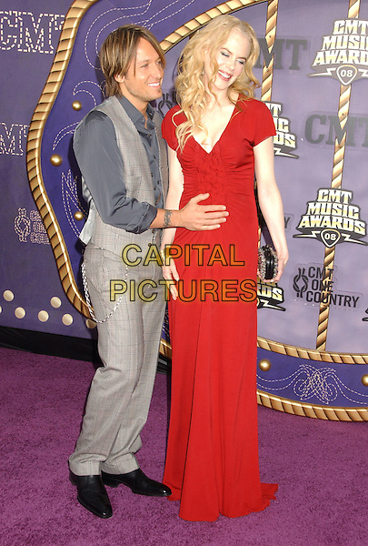 KEITH URBAN & NICOLE KIDMAN .2008 CMT Music Awards held at Curb Events Center at Belmont University, Nashville, Tennessee, USA, .14 April 2008..full length long red dress pregnant grey gray shirt waistcoat trousers married couple husband wife hand on tummy baby bump.CAP/ADM/LF.©Laura Farr/Admedia/Capital PIctures
