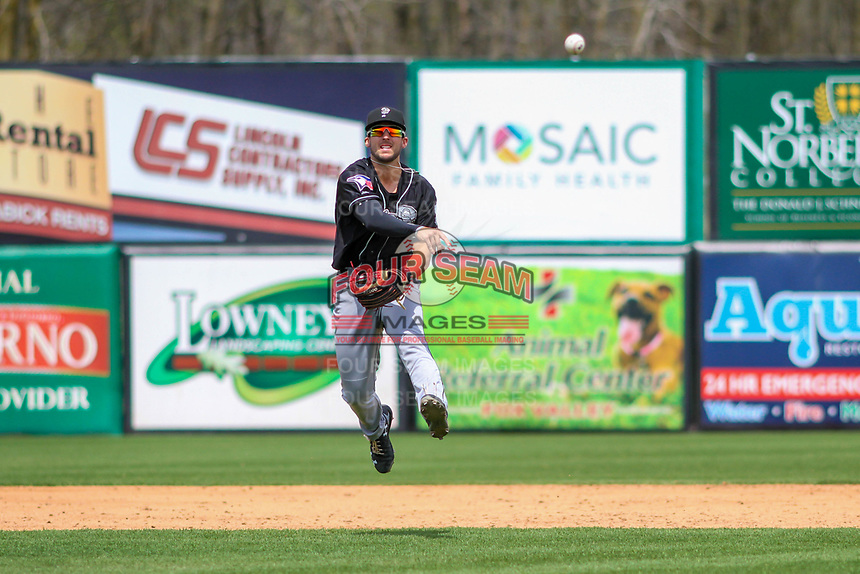 Lansing Lugnuts shortstop Kevin Smith (4) throws to first base during a Midwest League game against the Wisconsin Timber Rattlers on May 8, 2018 at Fox Cities Stadium in Appleton, Wisconsin. Lansing defeated Wisconsin 11-4. (Brad Krause/Four Seam Images)