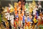 © Joel Goodman - 07973 332324 . 21 November 2013 . Manchester , UK . A trader reflected on a mirrored tray covered in colourful trinkets . Candid photos of the Christmas Markets in Manchester City Centre . Photo credit : Joel Goodman