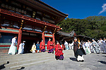 Priests exit the inner sanctuary  during the annual Reitaisai Grand Festival at Tsurugaoka Hachimangu Shrine in Kamakura, Japan on  14 Sept. 2012.  Sept 14 marks the first day of the 3-day Reitaisai festival, which starts early in the morning when shrine priests and officials perform a purification ritual in the ocean during a rite known as hamaorisai and limaxes with a display of yabusame horseback archery. Photographer: Robert Gilhooly