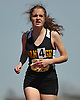 Tess Duignan, a Wantagh sophomore, legs out a second place finish in the girls 3,000 meter run during the Cougar Invitational held at Bellmore JFK High School on Saturday, Apr. 16, 2016.