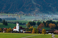 Church tower rises above village of Zell during autumn, Allgäu region, Bavaria, Germany