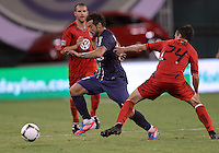 WASHINGTON, DC - July 28, 2012:  Lewis Neal (24) of DC United tries to stop Ezequiel Lavezzi (11) of PSG (Paris Saint-Germain) in an international friendly match at RFK Stadium in Washington DC on July 28. The game ended in a 1-1 tie.