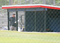 An evidence technician walks into the third base dugout as he makes notes as part of the crime scene investigation after a gunman opened fire on members of Congress who were practicing for the annual Congressional baseball game in Alexandria, Virginia on Wednesday, June 14, 2017. Photo Credit: Ron Sachs/CNP/AdMedia