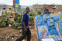 Rwanda. Southern province. Gitarama. District of Muhanga.  Market's stalls. A young black boy walks in the market. The Virgin Mary. Bananas. A giant poster for a campaign on HIV / Aids prevention. © 2007 Didier Ruef