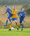 Tadhg Cronin of Treaty Celtic under pressure from Thomas Mc Guane and Damien Lineen. Photograph by Declan Monaghan