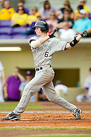 Brett Armour #6 of the Wake Forest Demon Deacons follows through on his swing against the LSU Tigers at Alex Box Stadium on February 19, 2011 in Baton Rouge, Louisiana.  The Tigers defeated the Demon Deacons 4-3.  Photo by Brian Westerholt / Four Seam Images