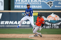 Erick Mejia (9) of the Rancho Cucamonga Quakes looks to first base after forcing out Cody Ramer (7) of the Inland Empire 66ers at second base during a game at LoanMart Field on May 7, 2017 in Rancho Cucamonga, California. Rancho Cucamonga defeated Inland Empire, 6-0. (Larry Goren/Four Seam Images)