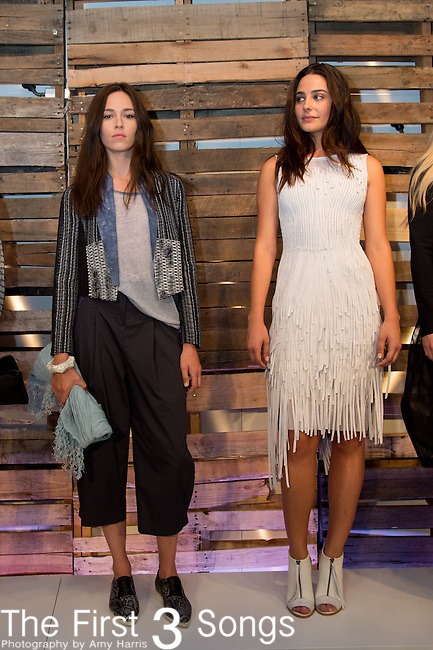 Models pose at the Elie Tahari presentation during Mercedes-Benz Fashion Week Spring 2015 in New York City.