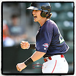 Ryan Fitzgerald (24) of the Greenville Drive shouts and pumps his fist after evading a rundown and scoring a run in Game 1 of a doubleheader against the Rome Braves on Friday, August 3, 2018, at Fluor Field at the West End in Greenville, South Carolina. Rome won, 7-6. (Tom Priddy/Four Seam Images)