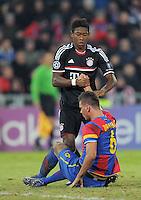 FUSSBALL   CHAMPIONS LEAGUE   SAISON 2011/2012  Achtelfinale Hinspiel   22.02.2012 FC Basel - FC Bayern Muenchen  David Alaba (FC Bayern Muenchen) hilft Aleksandar Dragovic (Boden, FC Basel) auf