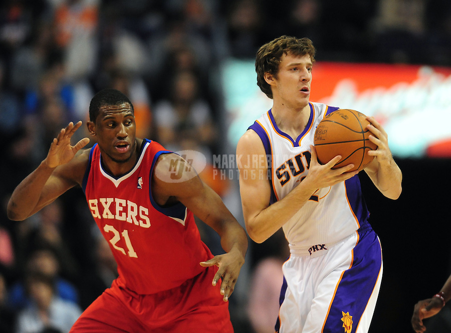 Dec. 29, 2010; Phoenix, AZ, USA; Philadelphia 76ers forward (21) Thaddeus Young defends Phoenix Suns guard (2) Goran Dragic at the US Airways Center. The 76ers defeated the Suns 123-110. Mandatory Credit: Mark J. Rebilas-