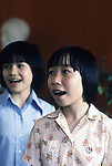 Members of the Young Pioneers sing  a hymn of praise to peace and Ho Chi Ming at the Dong Da Primary School in Hanoi, North Vietnam.  (Jim Bryant Photo)....