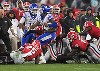 ATHENS, GA - OCTOBER 19: Lynn Bowden Jr. #1 of the Kentucky Wildcats is tackled by Quay Walker #25, Monty Rice #32 and Malik Herring #10 of the Georgia Bulldogs during a game between University of Kentucky Wildcats and University of Georgia Bulldogs at Sanford Stadium on October 19, 2019 in Athens, Georgia.