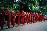 Monks receiving alms at Shwe Kyet Yet on Ayeyarwady River near Mandalay, Myanmar (Burma)