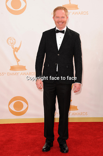 Jesse Tyler Ferguson arrives at the 65th Primetime Emmy Awards at Nokia Theatre on Sunday Sept. 22, 2013, in Los Angeles.<br />