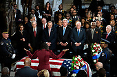 Maya Rockeymoore, widow of late United States Representative Elijah Cummings (Democrat of Maryland), raises her arms over the casket of Cummings during a memorial service in National Statuary Hall at the U.S. Capitol in Washington, D.C., U.S., on Thursday, Oct. 24, 2019. Cummings, a key figure in Democrats' impeachment inquiry and a fierce critic of US President Donald J. Trump, died at the age of 68 on October 17 due to complications concerning long-standing health challenges. Standing behind the casket in the front row, from left to right: Speaker of the US House of Representatives Nancy Pelosi (Democrat of California), US Senate Majority Leader Mitch McConnell (Republican of Kentucky), US Senate Minority Leader Chuck Schumer (Democrat of New York), US House Minority Leader Kevin McCarthy (Republican of California), US House Majority Leader Steny Hoyer (Democrat of Maryland), US House Assistant Democratic Leader James Clyburn (Democrat of South Carolina), and US Senator Ben Cardin (Democrat of Maryland).<br /> Credit: Al Drago / Pool via CNP