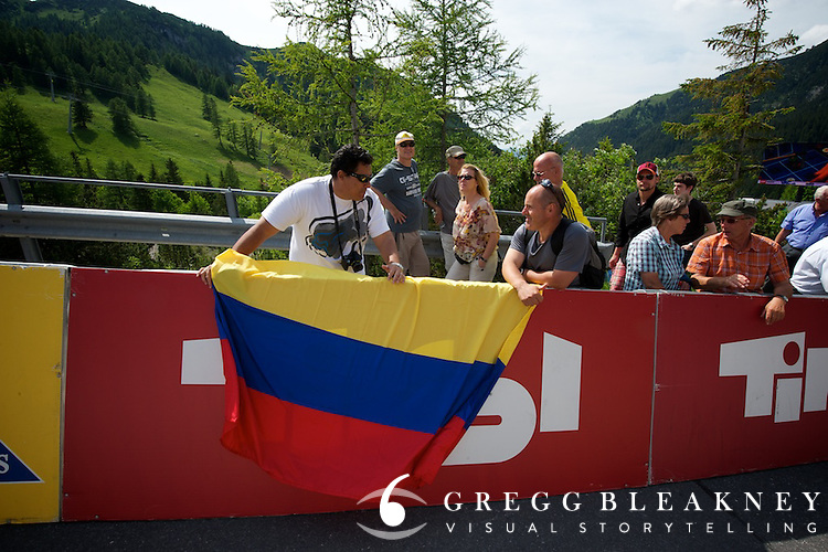 Colombian race fans wait at the finish line of stage 6 for the arrival of their hero, Juan Mauricio Soler.  Unfortunately, they soon learned that Soler would not complete to stage because of a terrible crash mid-stage--leaving him with a fractured skull and broken leg.