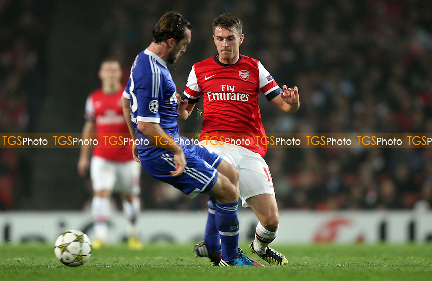 Aaron Ramsey of Arsenal and Christian Fuchs of Schalke - Arsenal vs FC Schalke 04, Champions League Group B at The Emirates Stadium, Arsenal - 24/10/12 - MANDATORY CREDIT: Rob Newell/TGSPHOTO - Self billing applies where appropriate - 0845 094 6026 - contact@tgsphoto.co.uk - NO UNPAID USE.