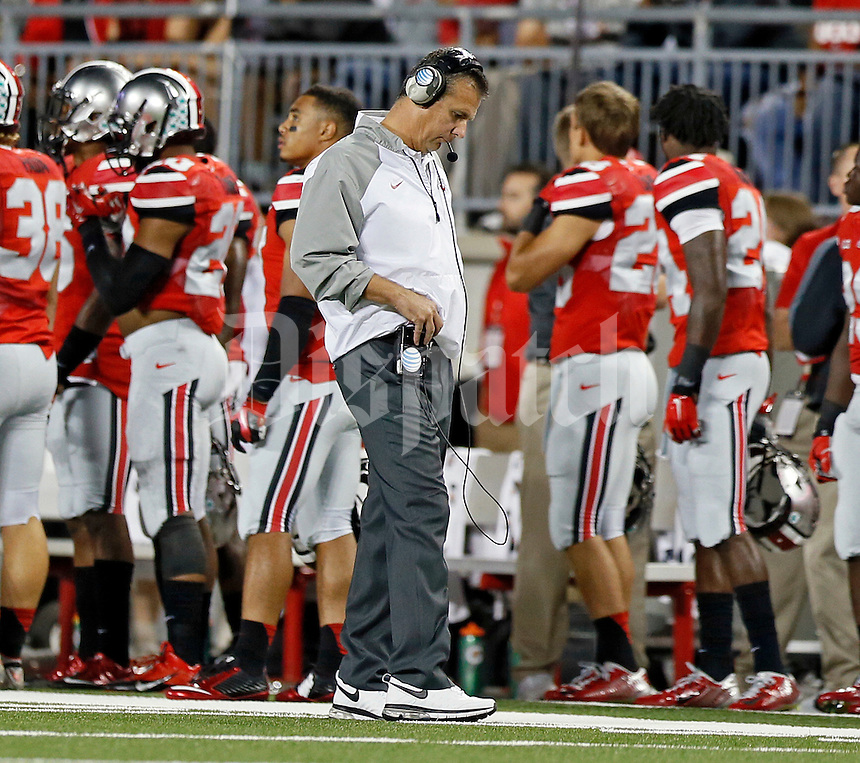 Ohio State Buckeyes head coach Urban Meyer looks down after Virginia Tech Hokies scored during the 2nd quarter of their game in Ohio Stadium on September 6, 2014.  (Dispatch photo by Kyle Robertson)