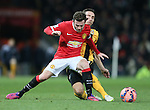 Juan Mata of Manchester United tackled by Tom Champion of Cambridge Utd - FA Cup Fourth Round replay - Manchester Utd  vs Cambridge Utd - Old Trafford Stadium  - Manchester - England - 03rd February 2015 - Picture Simon Bellis/Sportimage