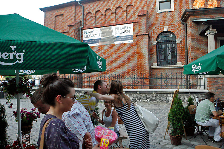 Before the fall of communism in Poland, the former Jewish neighborhood of Kazimerz in Krakow was run down and dangerous to visit at night. Today, the area draws thousdands of tourists a year from around the world. The neighborhood was once a bustling center of Jewish life before it was wiped out during WWII. Jewish-themed restaurants and cafes serve traditional Jewish and Polish cuisine and restored synagogues contain exhibits detailing pre-war Jewish life in Poland. Some controversy exists over anti-Semitic paintings and woodwork in some gift shops and restaurants. Kazimerz is also the center of Krakow's night life, where tourists and students visit a variety of bars and night clubs. Klezmer music has seen a comeback as well, and musicians play concerts weekly. A short walk across the river to the south takes you to the former wartime ghetto and Oscar Schindler's factory, famously depicted in Steven Spielberg's film Schindler's List. The film was one of the determining factors in bringing attention to the Kazimerz district, resulting in massive restoration efforts.