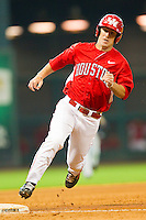 Pinch-runner Joel Ansley #4 of the Houston Cougars rounds third base on his way to score a run against the Kentucky Wildcats at Minute Maid Park on March 5, 2011 in Houston, Texas.  Photo by Brian Westerholt / Four Seam Images