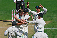 Players congratulate Tim Southee on taking the wicket of Jonny Bairstow caught and bowled, New Zealand Black Caps v England. Day 1 of the day-night, pink ball cricket test match at Eden Park in Auckland. 22 March 2018. Copyright Image: William Booth / www.photosport.nz
