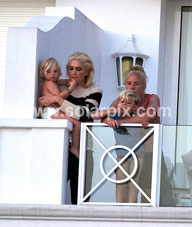 **ALL ROUND EXCLUSIVE PICTURES FROM SOLARPIX.COM**                                             **UK AND SPAIN SYNDICATION RIGHTS ONLY**                                                                                  Caption:  Gwen Stefani with Gavin Rossdale and her sons Zuma and Kingston at the balcony at Cap du Eden Roc Hotel during the 64th Cannes Film Festival in France                                                                            JOB REF: 13361       CPR/Kongsted       DATE:17.05.2011                                                            **MUST CREDIT SOLARPIX.COM OR DOUBLE FEE WILL BE CHARGED**                                                                      **MUST AGREE FEE BEFORE ONLINE USAGE**                               **CALL US ON: +34 952 811 768 or LOW RATE FROM UK 0844 617 7637**