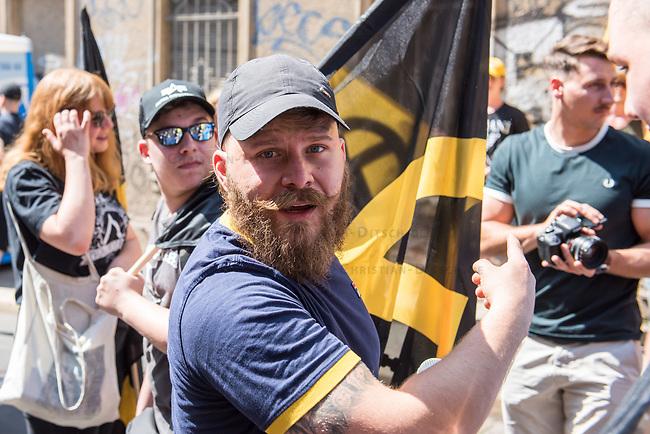 """Am Samstag den 20 Juli 2019 versuchten in Halle an der Saale ca. 200 Mitglieder und Anhaenger der rechtsextremen """"Identitaeren Bewegung"""", IB, eine Demonstration durchzufuehren. Sie versammelten sich dafuer vor dem Haus der IB in der Adam-Kuckhoff-Straße 16. Aufgrund von Gegenprotesten konnten die Rechtsextremen jedoch nicht marschieren, da alle Straßen um ihr Haus von Gegendemonstranten blockiert wurden.<br /> Im Bild: Alexander """"Malenki"""" Kleine, Blogger und Youtube-Aktivist fuer die Identitaere Bewegung, IB.<br /> 20.7.2019, Berlin<br /> Copyright: Christian-Ditsch.de<br /> [Inhaltsveraendernde Manipulation des Fotos nur nach ausdruecklicher Genehmigung des Fotografen. Vereinbarungen ueber Abtretung von Persoenlichkeitsrechten/Model Release der abgebildeten Person/Personen liegen nicht vor. NO MODEL RELEASE! Nur fuer Redaktionelle Zwecke. Don't publish without copyright Christian-Ditsch.de, Veroeffentlichung nur mit Fotografennennung, sowie gegen Honorar, MwSt. und Beleg. Konto: I N G - D i B a, IBAN DE58500105175400192269, BIC INGDDEFFXXX, Kontakt: post@christian-ditsch.de<br /> Bei der Bearbeitung der Dateiinformationen darf die Urheberkennzeichnung in den EXIF- und  IPTC-Daten nicht entfernt werden, diese sind in digitalen Medien nach §95c UrhG rechtlich geschuetzt. Der Urhebervermerk wird gemaess §13 UrhG verlangt.]"""