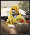"""11/08/2002                   Copyright Pic : James Stewart.File Name : stewart-one big sunday  03.ONE YOUNG BOY BRAVES THE WEATHER TODAY, 11TH AUG 2002, AT THE RADIO 1 """"ONE BIG SUNDAY CONCERT IN FALKIRK.....Payments to :-.James Stewart Photo Agency, 19 Carronlea Drive, Falkirk. FK2 8DN      Vat Reg No. 607 6932 25.Office     : +44 (0)1324 570906     .Mobile  : +44 (0)7721 416997.Fax         :  +44 (0)1324 570906.E-mail  :  jim@jspa.co.uk.If you require further information then contact Jim Stewart on any of the numbers above........."""