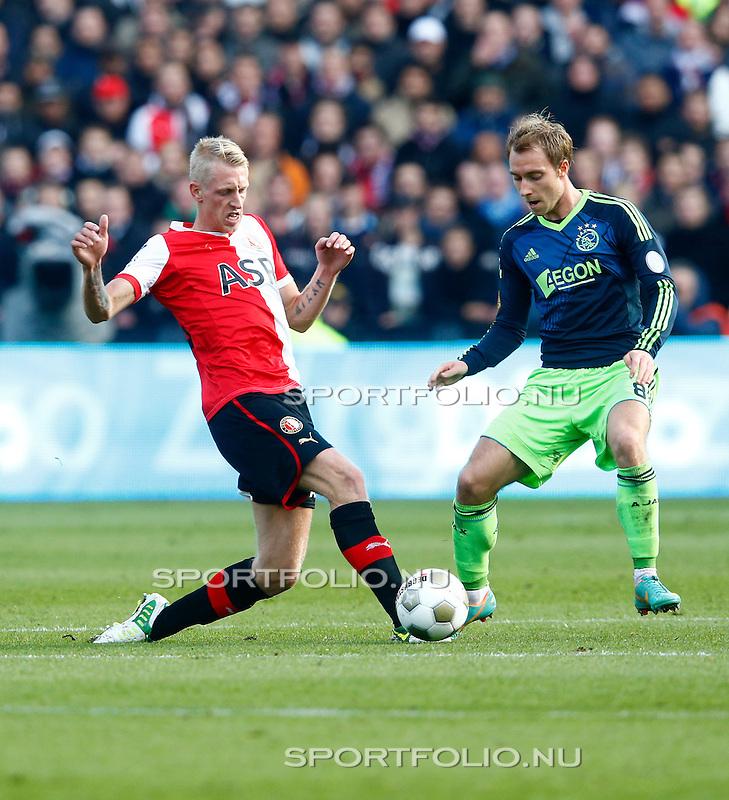 Nederland, Rotterdam, 28 oktober 2012.Eredivisie.Seizoen 2012-2013.Feyenoord-Ajax.Lex Immers (l.) van Feyenoord en Christian Eriksen (r.) van Ajax strijden om de bal.