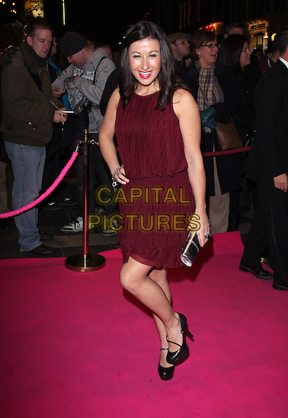 HAYLEY TAMADDON  .Press night for 'My Trip DownThe Pink Carpet' at the Apollo Theatre, Shaftesbury Avenue, London, England..February 3rd 2011.full length black mary janes shoes clutch bag sleeveless purple maroon dress pink hand on hip.CAP/ROS.©Steve Ross/Capital Pictures