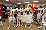 Wisconsin Badgers running backs celebrates with the Paul Bunyan Axe in the locker room after an NCAA College Big Ten Conference football game against the Minnesota Golden Gophers Saturday, November 25, 2017, in Minneapolis, Minnesota. The Badgers won 31-0. (Photo by David Stluka)