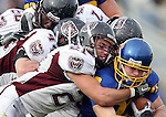 BROOKINGS, SD - NOVEMBER 6: Kyle Minett #30 of South Dakota State University is brought down by a host of defenders including Skylar Smith #21 of Missouri State in the first quarter of their game Saturday afternoon at Coughlin Alumni Stadium in Brookings. (photo by Dave Eggen/Inertia)
