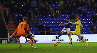 Oldham Athletic's Eoin Doyle (C) has a shot at goal despite the attentions of AFC Wimbledon's George Francomb (R)  during the Sky Bet League 1 match between Oldham Athletic and AFC Wimbledon at Boundary Park, Oldham, England on 21 November 2017. Photo by Juel Miah/PRiME Media Images