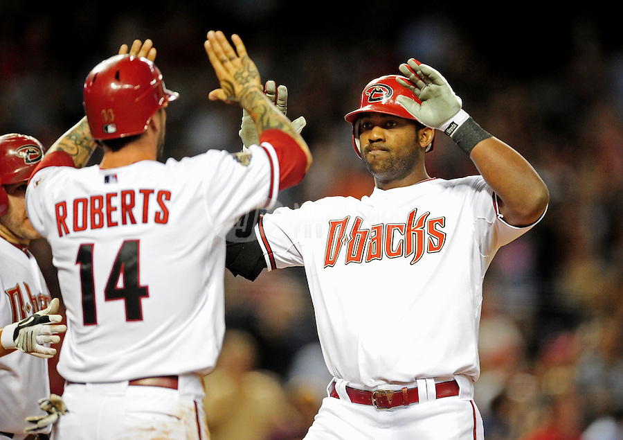 Apr. 12, 2011; Phoenix, AZ, USA; Arizona Diamondbacks batter Juan Miranda (right) is congratulated by teammate Ryan Roberts after hitting a three run home run in the sixth inning against the St. Louis Cardinals at Chase Field. Mandatory Credit: Mark J. Rebilas-