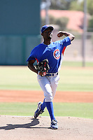 Willengton Cruz #66 of the Chicago Cubs pitches in an extended spring training game against the Arizona Diamondbacks at the Cubs minor league complex on June 4, 2011  in Mesa, Arizona. .Photo by:  Bill Mitchell/Four Seam Images.