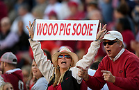 NWA Democrat-Gazette/CHARLIE KAIJO Arkansas Razorbacks fans cheer in the first half during a football game on Friday, November 24, 2017 at Razorback Stadium in Fayetteville.
