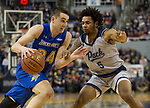 South Dakota State guard Alex Arians (34) drives against Nevada's Nisre Zouzoua (5) in the second half of an NCAA college basketball game in Reno, Nev., Saturday, Dec. 15, 2018. (AP Photo/Tom R. Smedes)