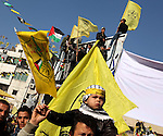 Palestinian Fatah supporters take part in a rally marking the 48th anniversary of the founding of the Fatah movement, in Gaza City January 4, 2013. Fatah held its anniversary rally for the first time since 2007 in Gaza Strip. Photo by Ashraf Amra