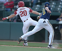 NWA Democrat-Gazette/ANDY SHUPE<br />Arkansas second baseman Carson Shaddy (20) avoids the tag from Kent State first baseman Brad Hamilton Friday, March 9, 2018, for a run-scoring bunt base hit during the fourth inning at Baum Stadium in Fayetteville. Visit nwadg.com/photos to see more photographs from the game.