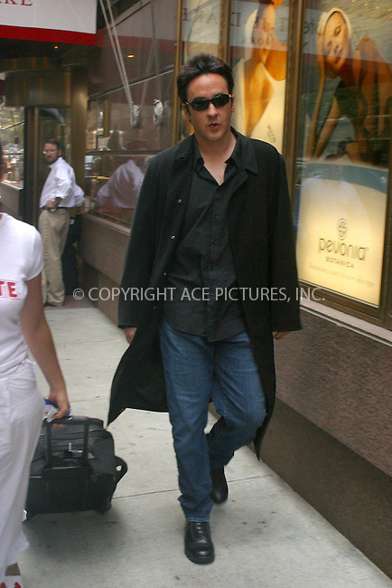 WWW.ACEPIXS.COM . . . . .  ....NEW YORK, JULY 25, 2005....John Cusack seen outside his midtown hotel.....Please byline: PAUL CUNNINGHAM - ACE PICTURES.... *** ***..Ace Pictures, Inc:  ..Craig Ashby (212) 243-8787..e-mail: picturedesk@acepixs.com..web: http://www.acepixs.com
