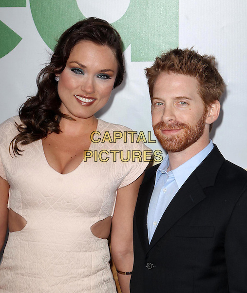 Clare Grant & Seth Green.The L.A. Premiere of 'Ted' held at The Grauman's Chinese Theatre in Hollywood, California, USA..June 21st, 2012.half length suit beige cream dress cut out away sides tall short married husband wife blue black beard facial hair .CAP/ADM/KB.©Kevan Brooks/AdMedia/Capital Pictures.