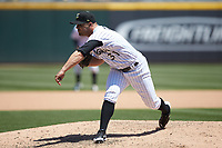 Charlotte Knights relief pitcher Xavier Cedeno (31) follows through on his delivery against the Gwinnett Stripers at BB&T BallPark on May 2, 2018 in Charlotte, North Carolina.  The Knights defeated the Stripers 6-5.  (Brian Westerholt/Four Seam Images)