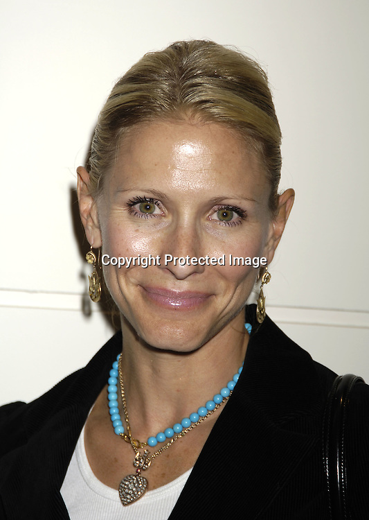 Kelley Menighan Hensley..at at reception in honor of Mary Alice Dwyer-Dobbin on her ..leaving P and G on September 29, 2005 at the offices of ..P and G. ..Photo by Robin Platzer, Twin Images