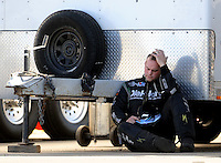 Nov 14, 2010; Pomona, CA, USA; NHRA funny car driver Matt Hagan reacts after losing in the first round during the Auto Club Finals at Auto Club Raceway at Pomona. Mandatory Credit: Mark J. Rebilas-