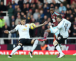 West Ham's Enner Valencia tussles with Manchester United's Marcos Rojo and Wayne Rooney<br /> <br /> Barclays Premier League- West Ham United vs Manchester United  - Upton Park - England - 8th February 2015 - Picture David Klein/Sportimage